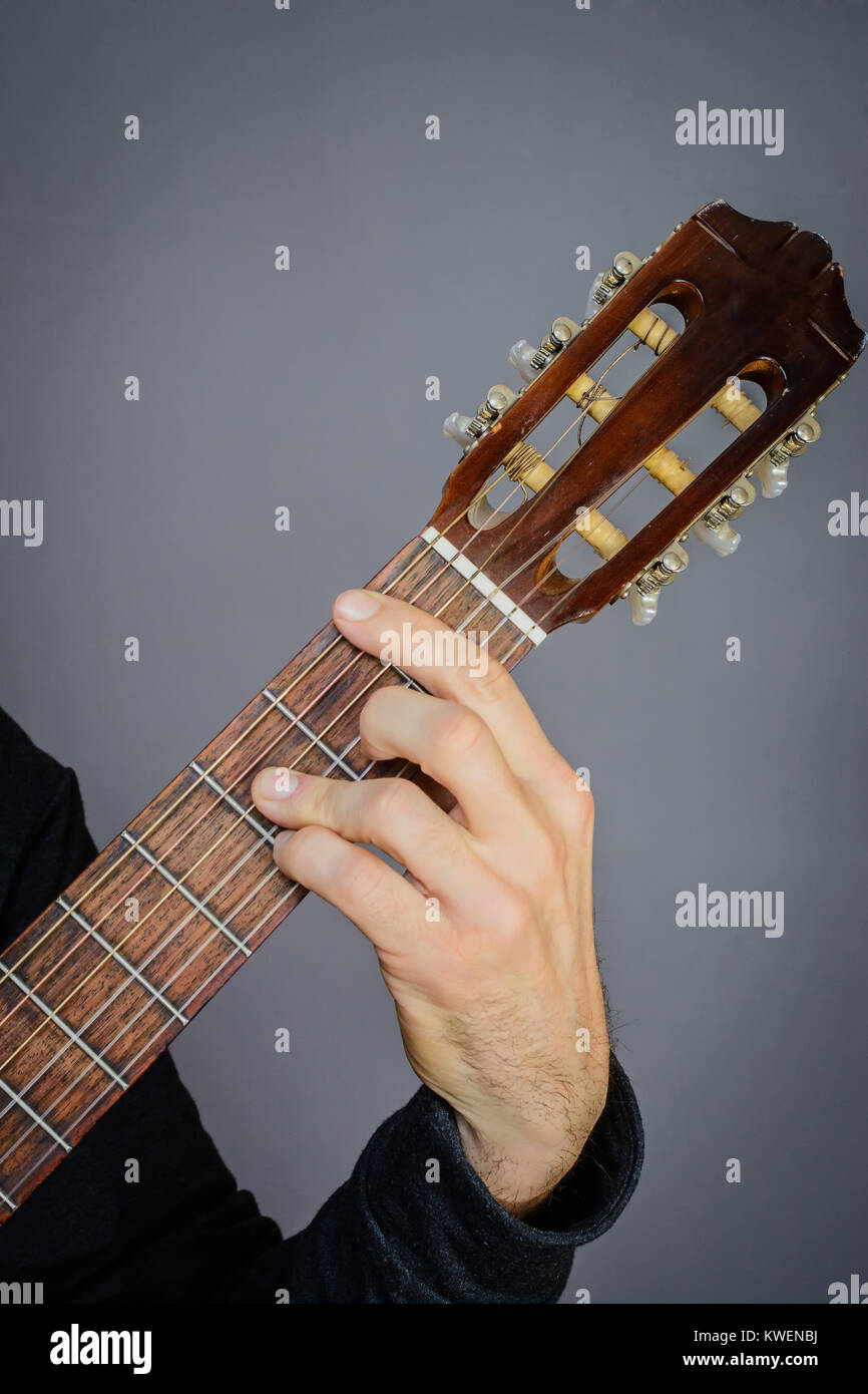 Guitarist Playing An Bb Major Chord On Classical Acoustic Guitar