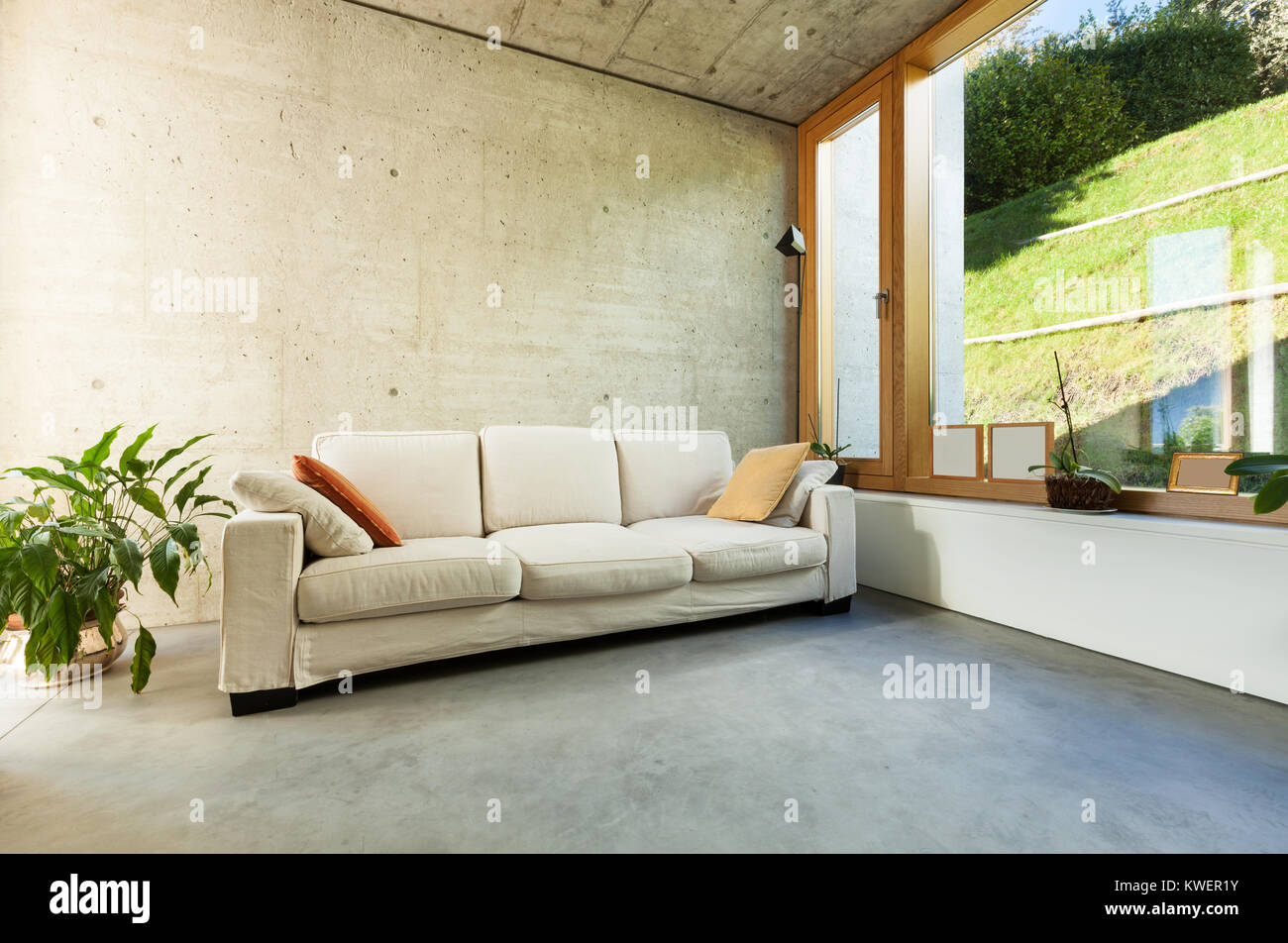 Beautiful modern house in cement interiors room with divan
