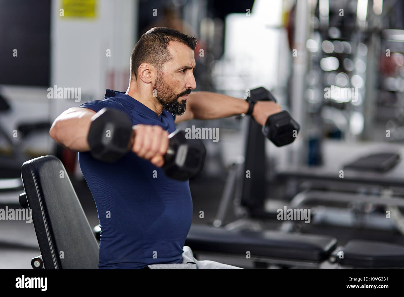 Man Doing Shoulder Workout With Dumbbells