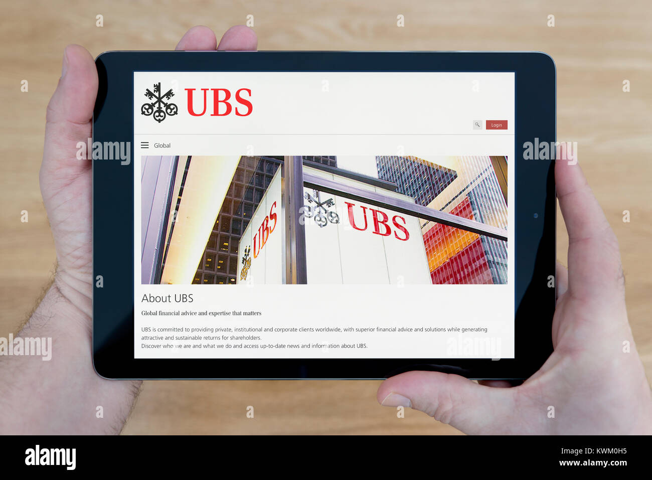 Logo swiss bank ubs stock photos logo swiss bank ubs stock a man looks at the ubs bank website on his ipad tablet device over a buycottarizona Image collections