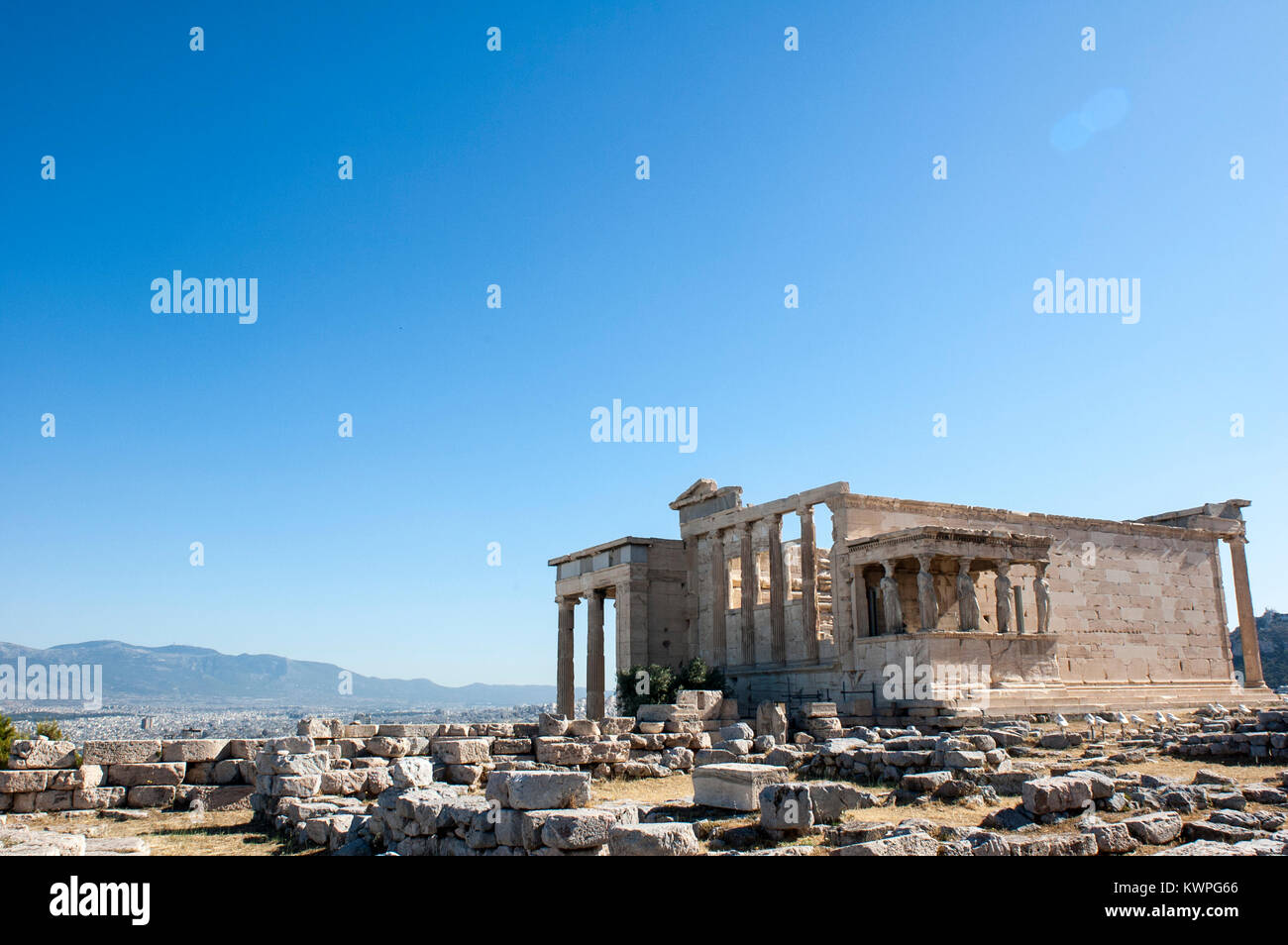 Panoramic background with acropolis porch of caryatids panoramic background with acropolis porch of caryatids erechtheum temple in athens greece voltagebd Choice Image
