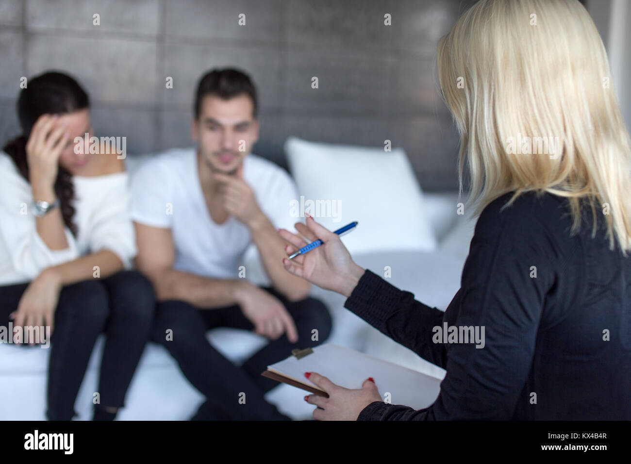 Blonde Therapist Discussing With Couple On Consulation Couple Stock