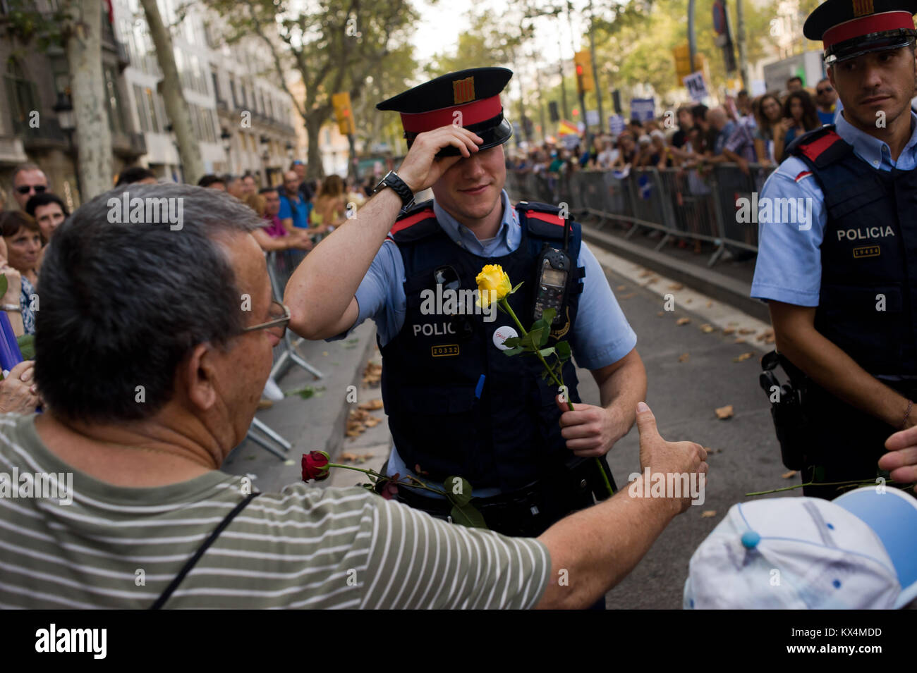 August 26 2017 barcelona catalonia spain in barcelona catalan august 26 2017 barcelona catalonia spain in barcelona catalan police officers receive roses and greetings during a march against terror attacks m4hsunfo
