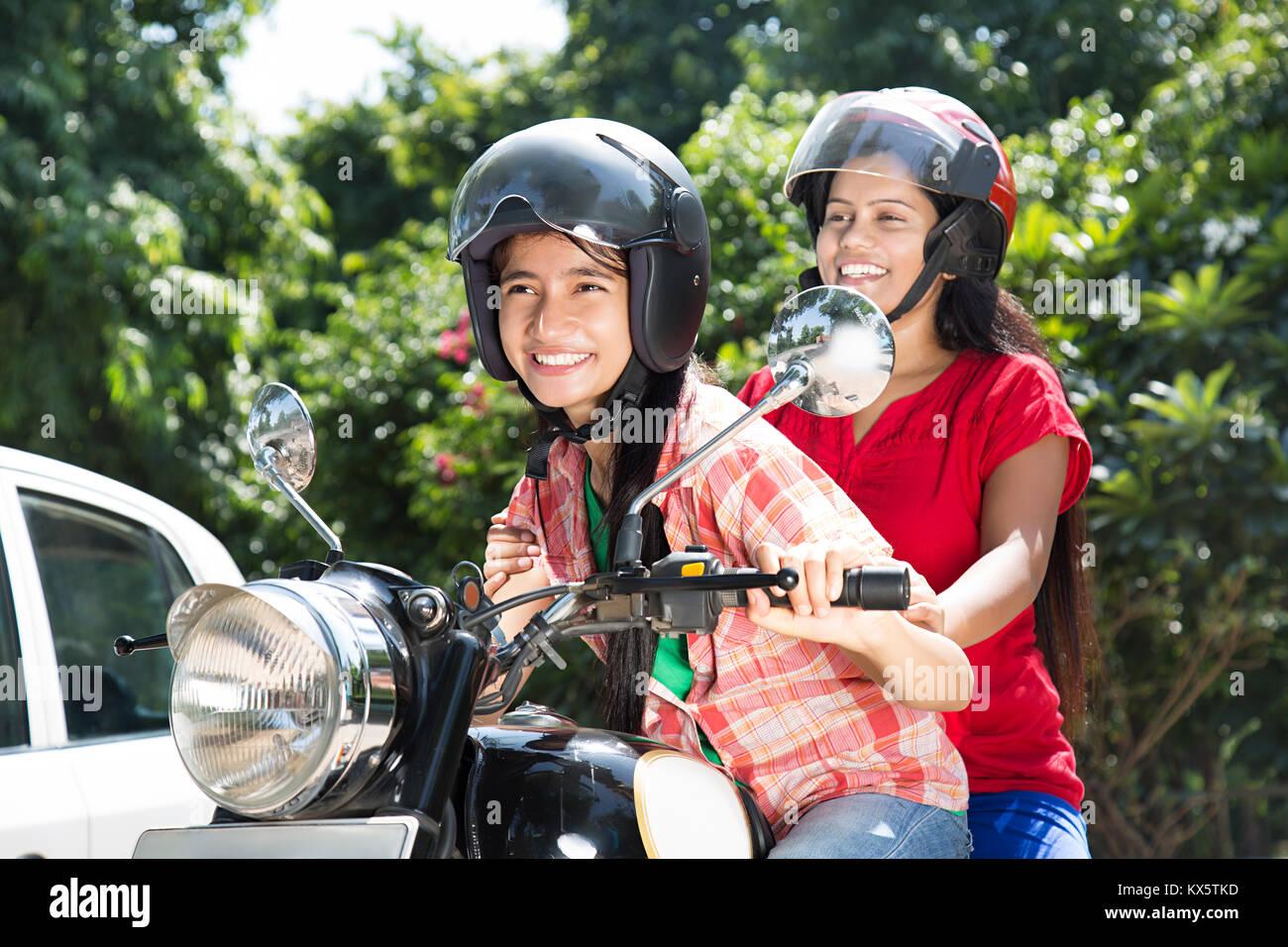 2 Indian Teenager Girls Friend Ride Bike Showing Thumbsup Enjoying