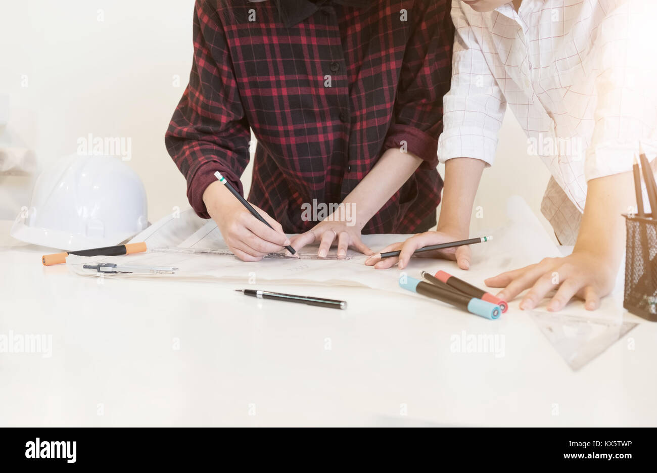 architectural drawing concept two people young business draw a