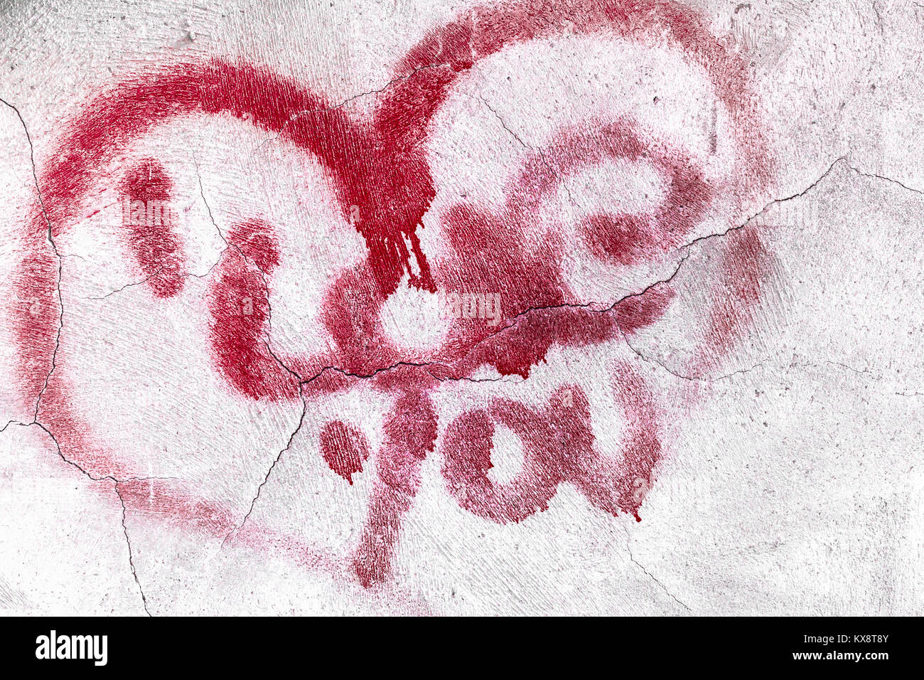 Red broken heart symbol with love message on textured cracked wall red broken heart symbol with love message on textured cracked wall background biocorpaavc