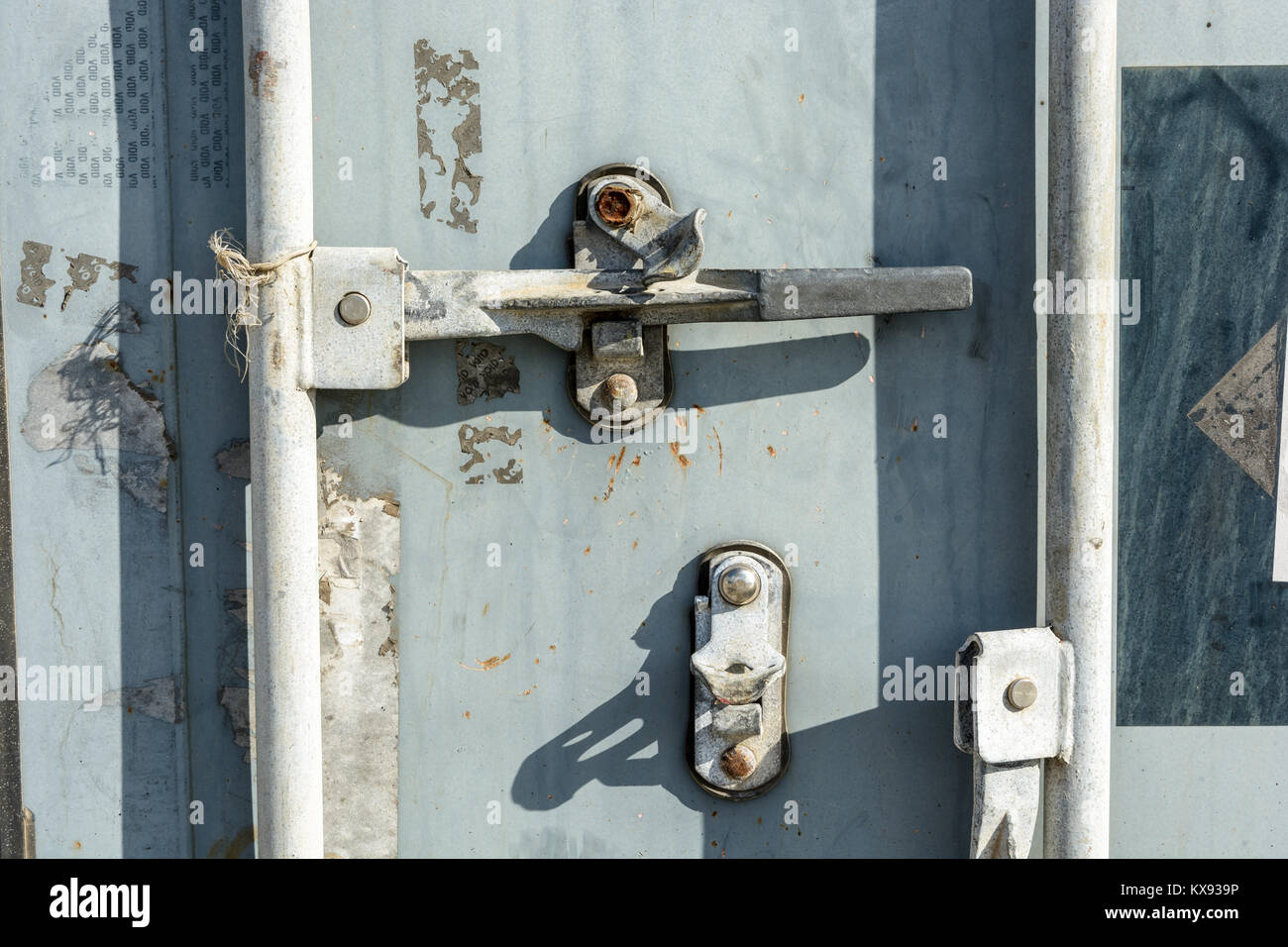 Closeup view of the worn door handle lock of an intermodal shipping