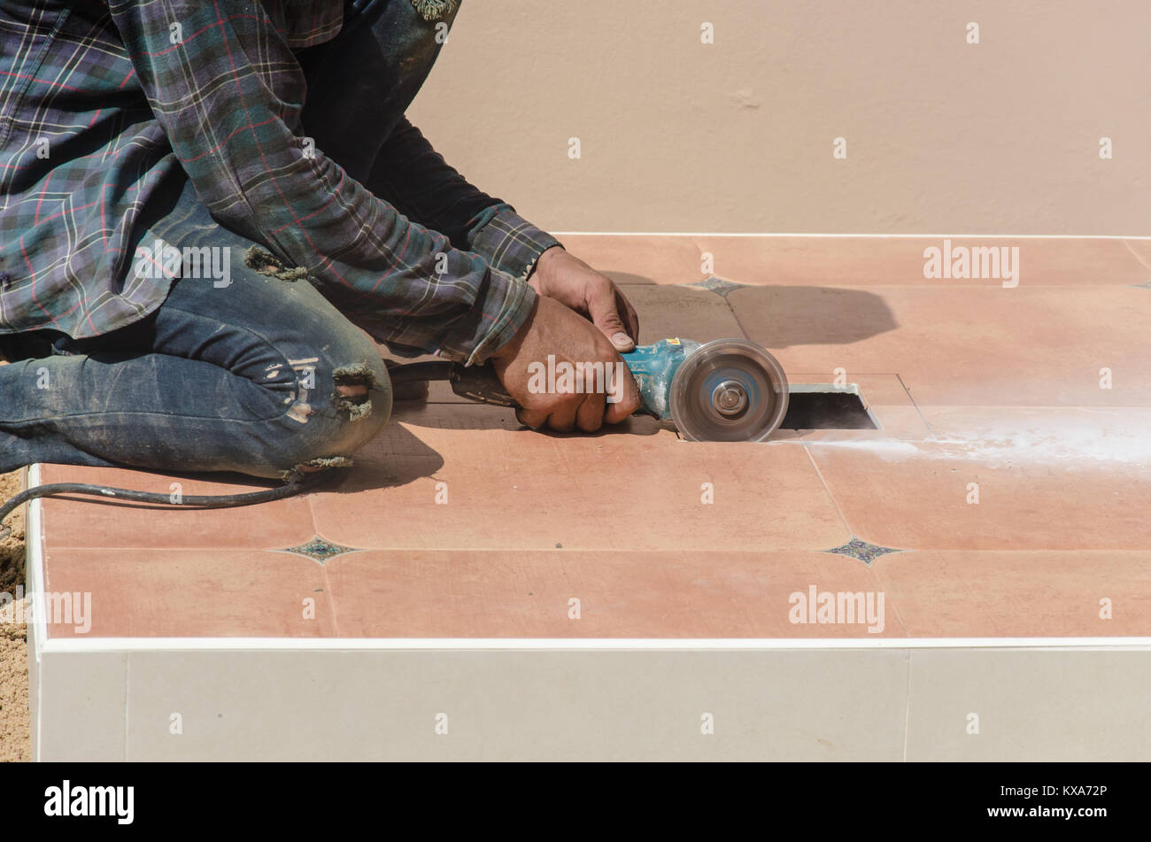 Electric tile cutter stock photos electric tile cutter stock drill work using tile cutting tool stock image dailygadgetfo Image collections