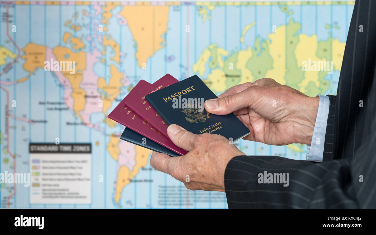 UK or US Citizen with passports and world map of timezones Stock ...