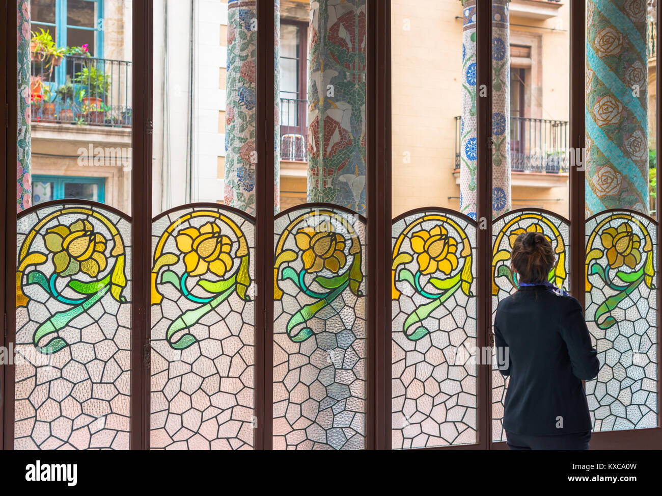 Palace glass windows stock photos palace glass windows stock tour guide looks out of decorative stained glass windows at the palace of catalan music planetlyrics Image collections