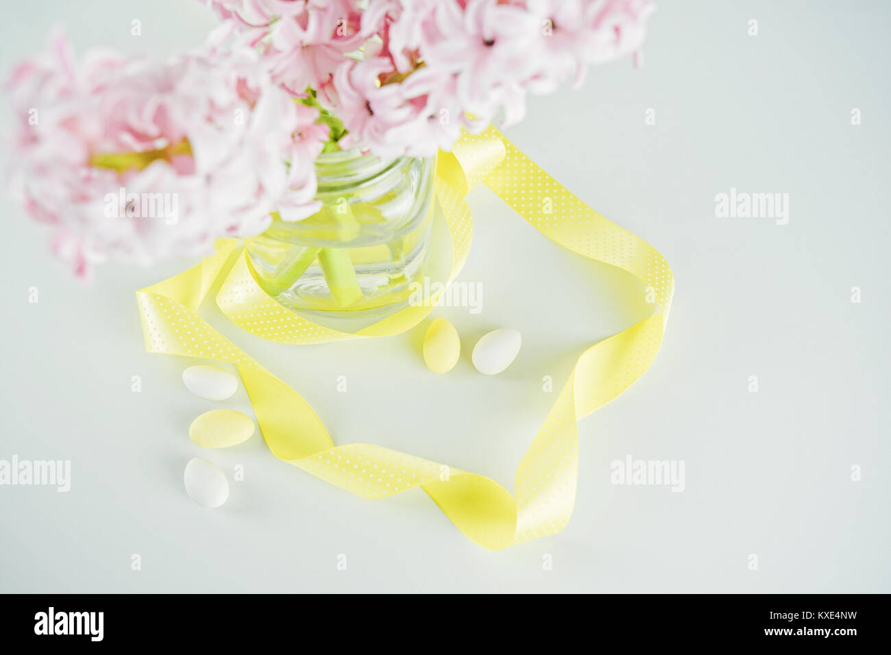 Fresh flowers hyacinth in glass vase with yellow ribbon top view fresh flowers hyacinth in glass vase with yellow ribbon top view reviewsmspy
