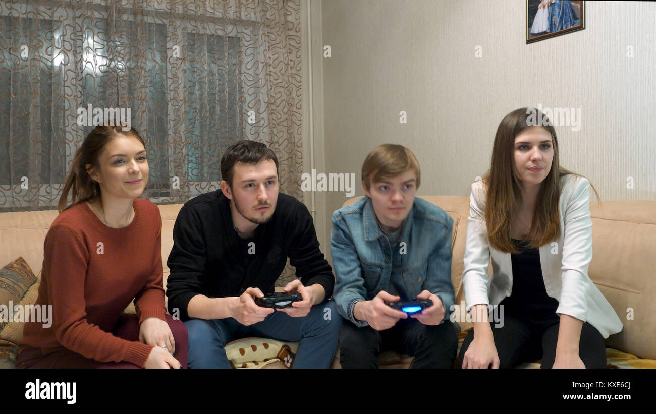 two couples play game console group of friends having fun and play