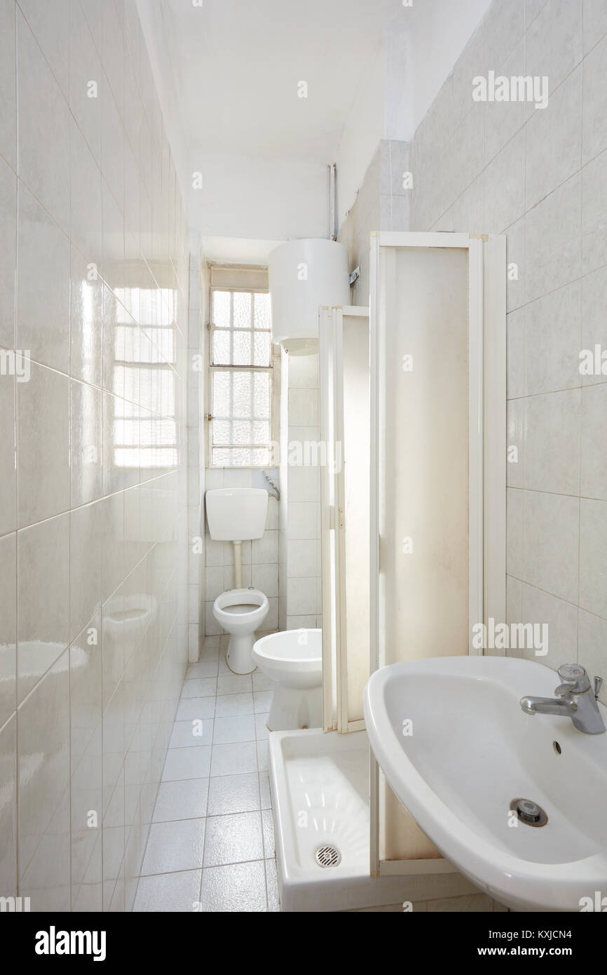 Old bathroom interior with tiled floor and walls Stock Photo ...