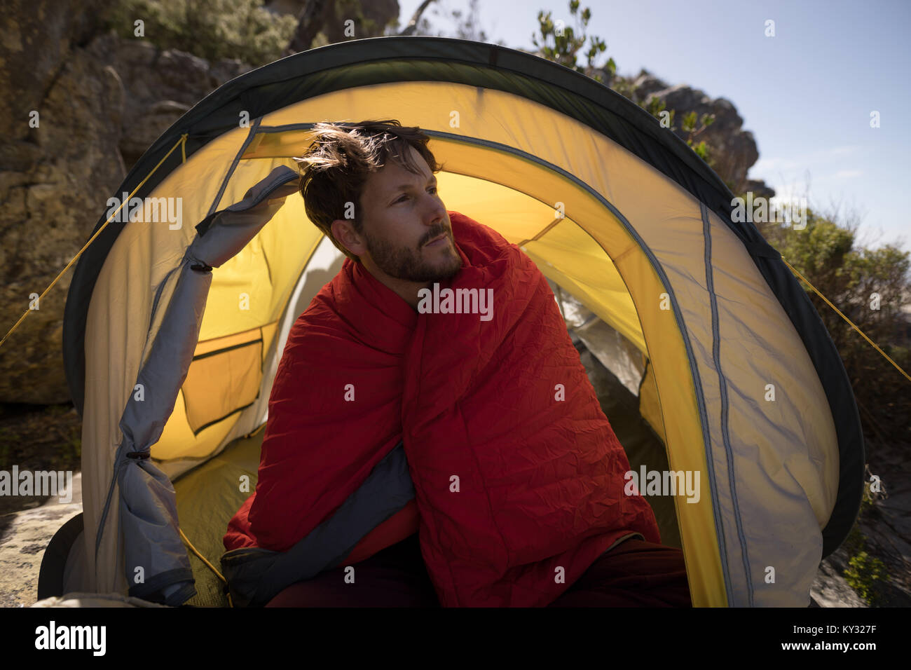 Hiker wrapped in blanket sitting in tent & Hiker wrapped in blanket sitting in tent Stock Photo Royalty Free ...