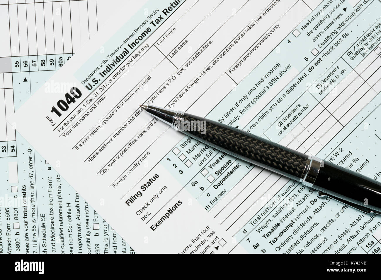 1040 tax form stock photos 1040 tax form stock images alamy pen laying on 2017 irs form 1040 stock image falaconquin