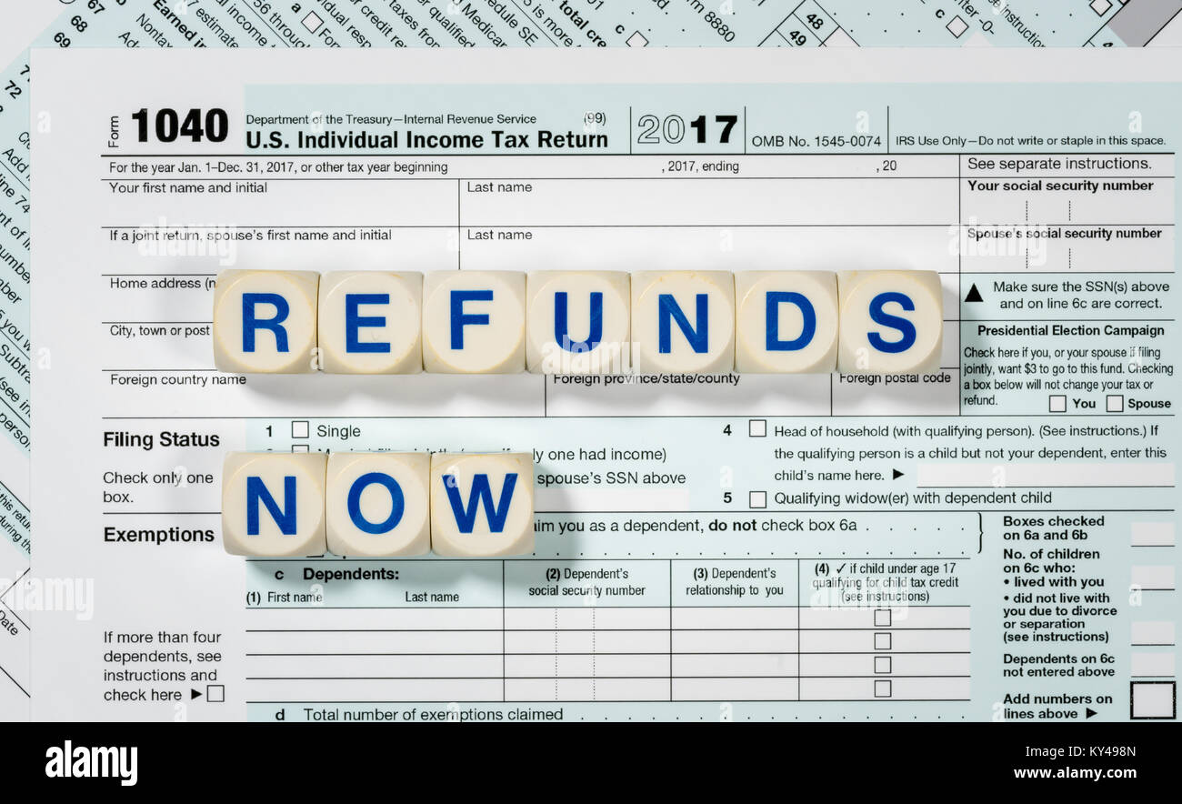 Macro close up of 2017 irs form 1040 with refunds now letters macro close up of 2017 irs form 1040 with refunds now letters falaconquin