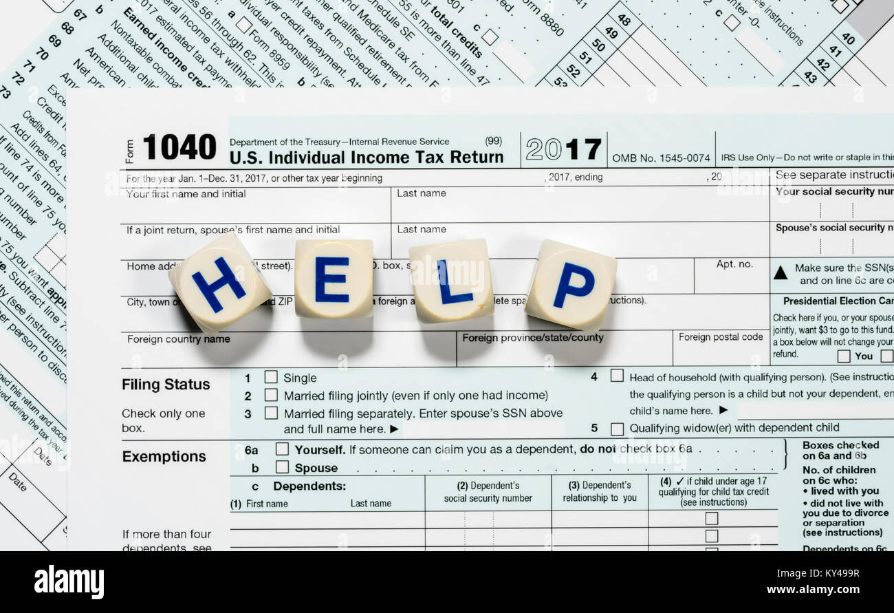Macro close up of 2017 irs form 1040 with help letters stock photo macro close up of 2017 irs form 1040 with help letters falaconquin