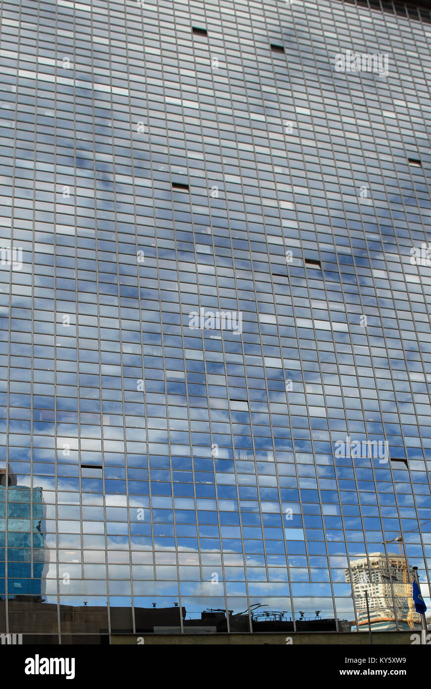 Huge glass wall from windows, in which a round, multi-storey ...