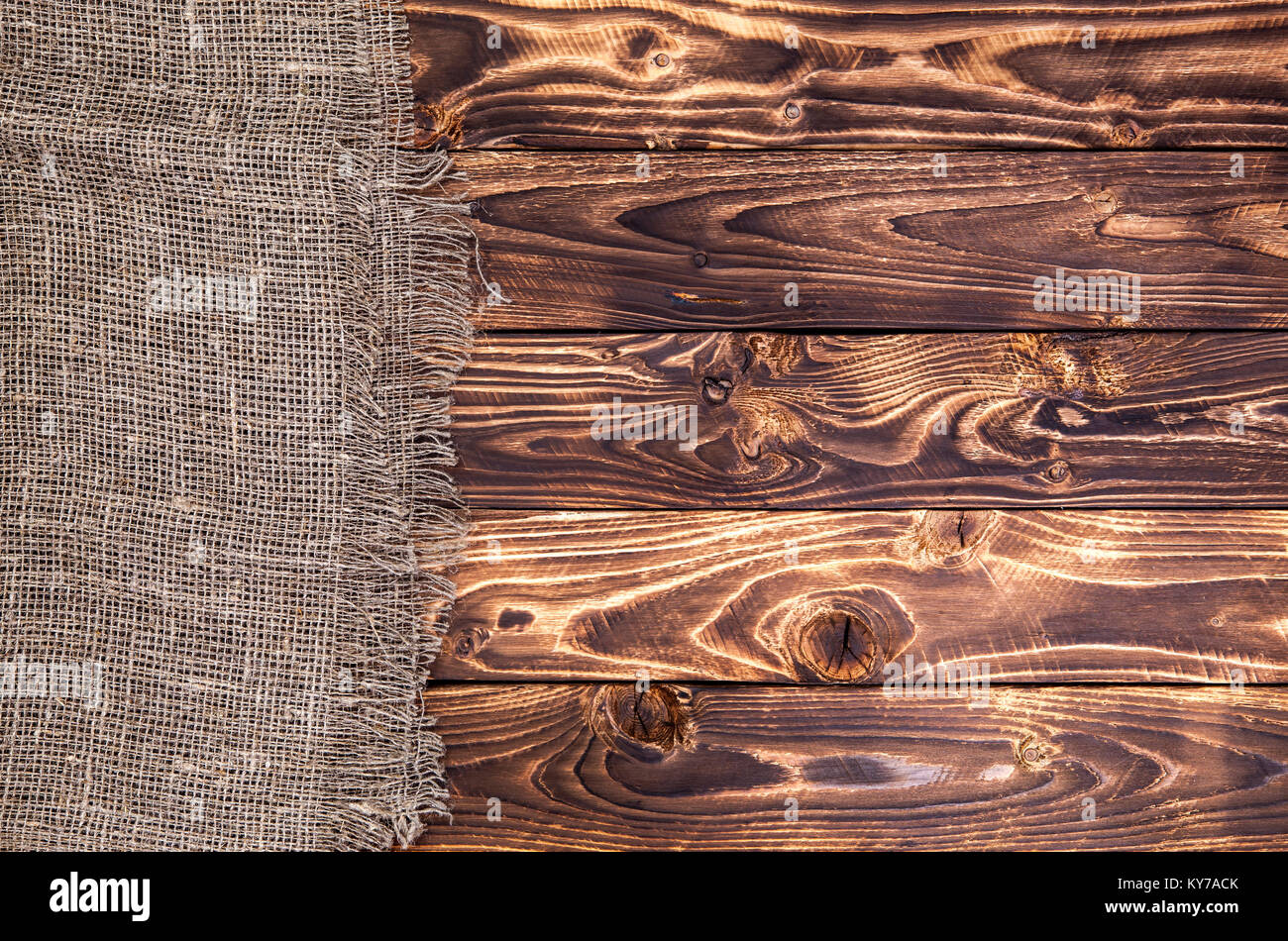 Dark Wooden Background With Burlap Rustic Wood And Sack Stock Photo