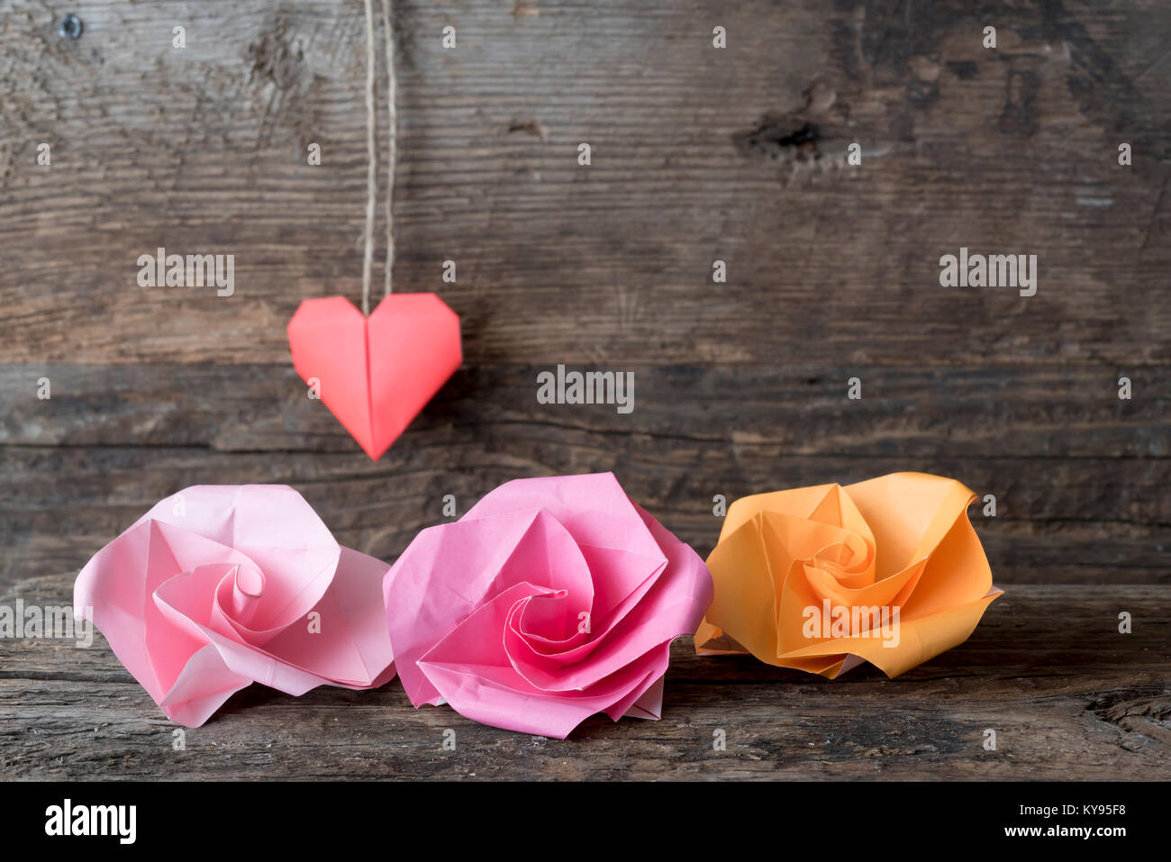 Origami Paper Flowers In Red Pink And Orange For Valentines Day