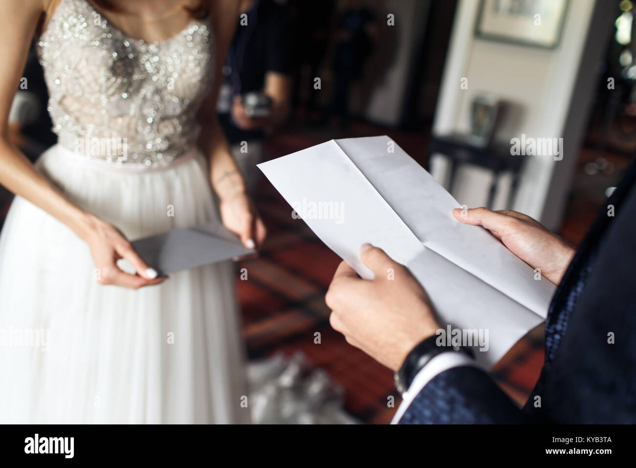 the groom is reading a letter to the bride