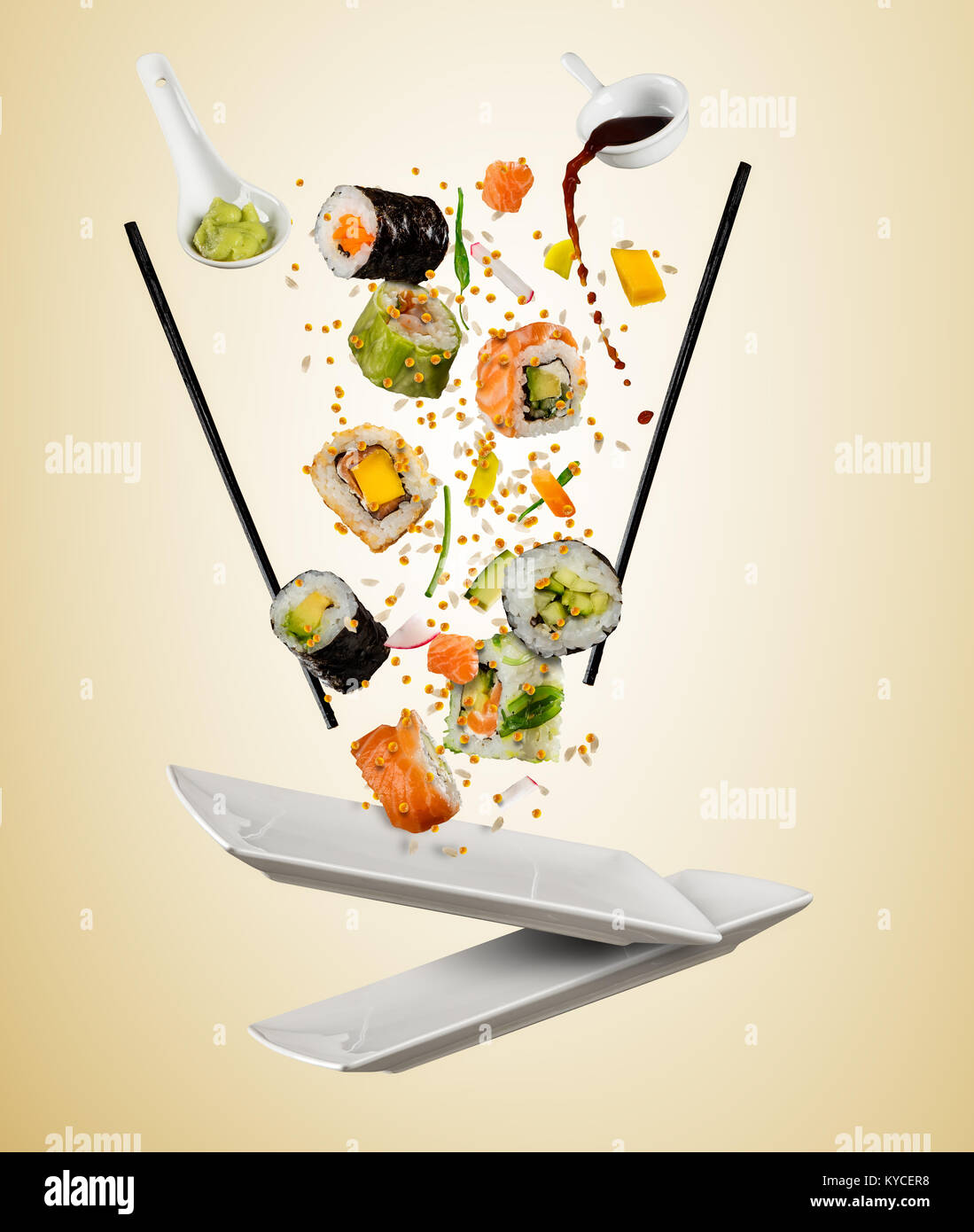 Flying Pieces Of Sushi With Wooden Chopsticks Separated On Beige