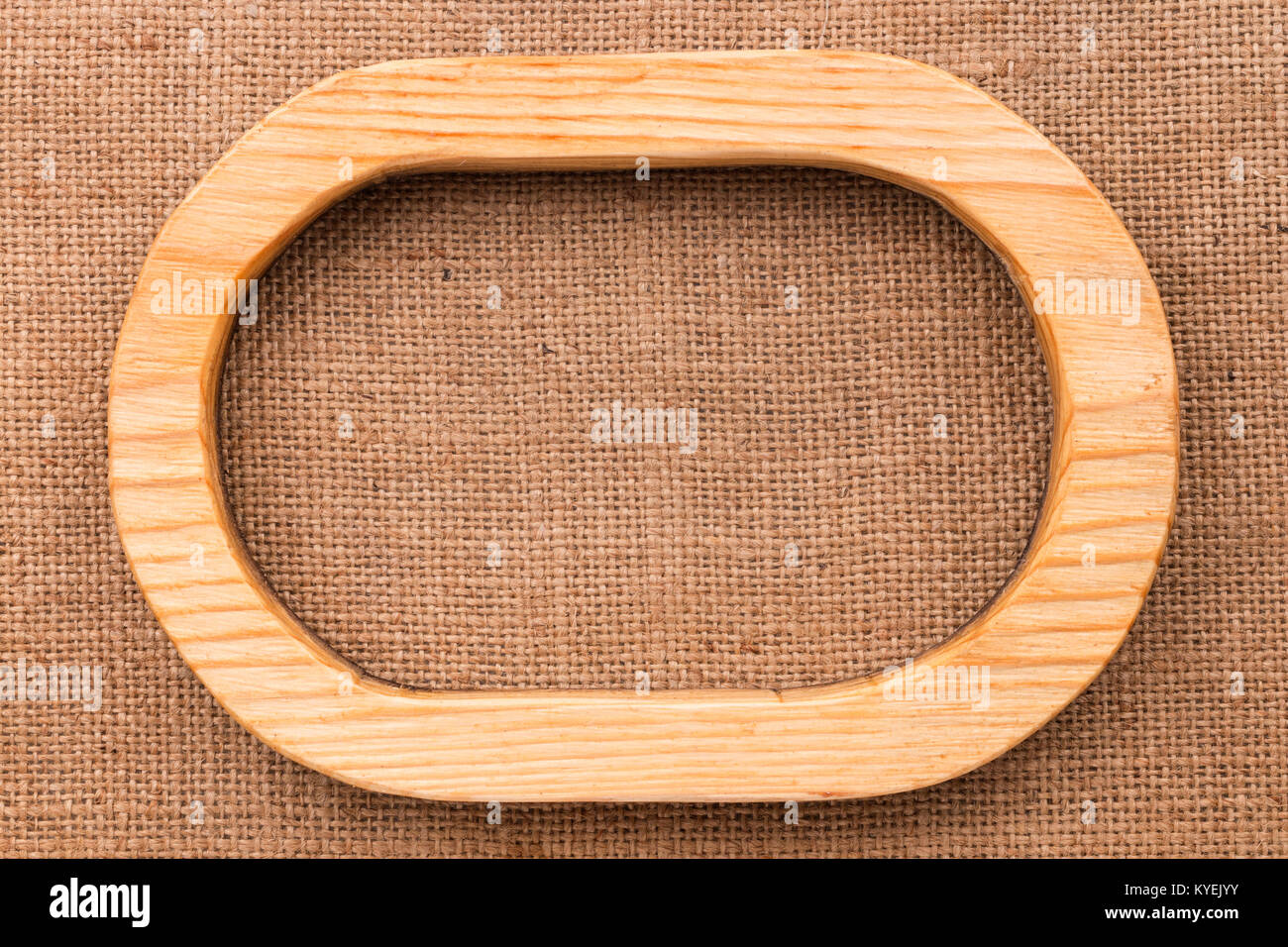 One-piece oval wooden frame lying on burlap. Natural patterns Stock ...