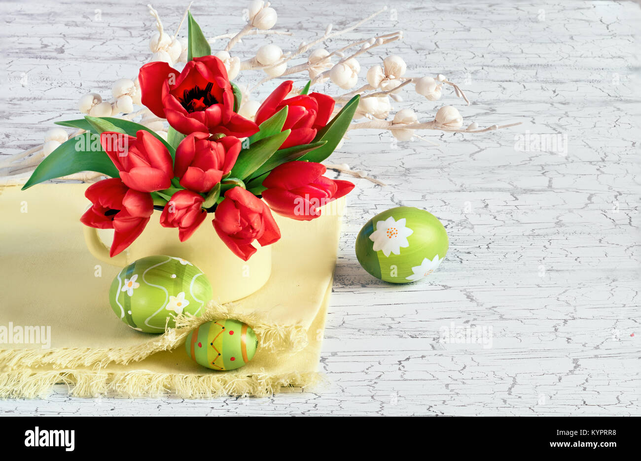 Red Tulips With Luight Green Easter Eggs On White Cracked Background