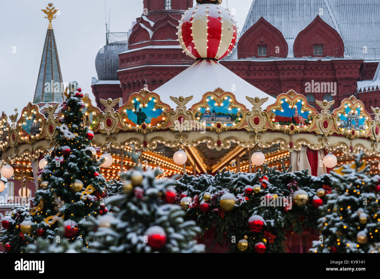 Snow Covered Decorated Christmas Trees Illuminated Merry Go