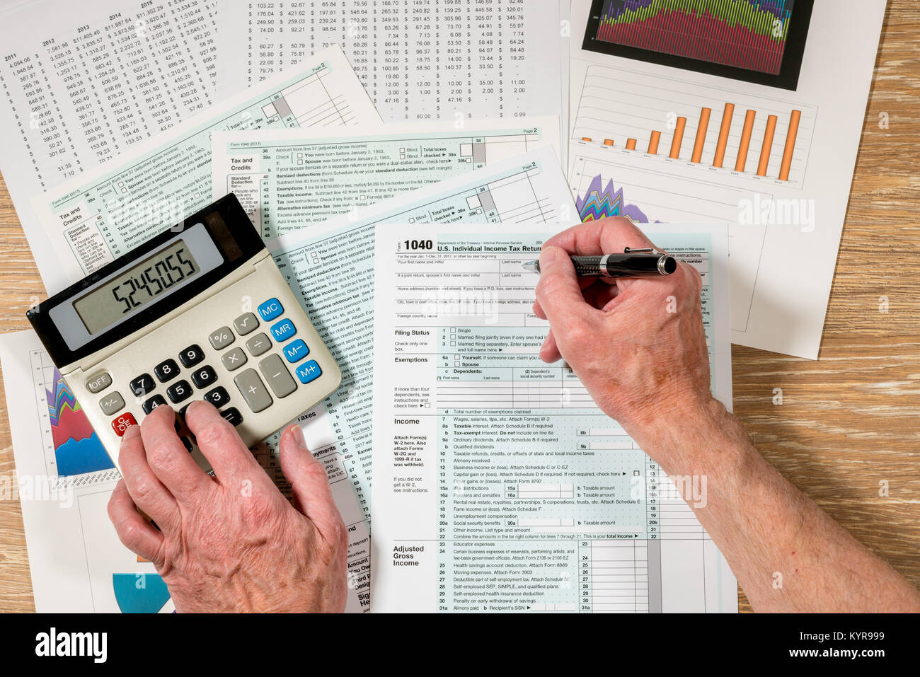 Return service desk stock photos return service desk stock images from above view of 2017 irs form 1040 on wooden desk stock image falaconquin