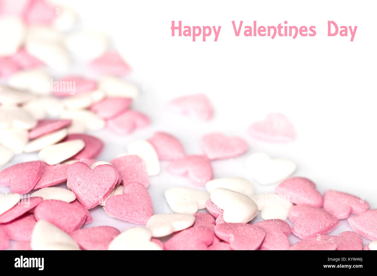 Valentines Card Pink Sugar Hearts On White Background Stock Photo
