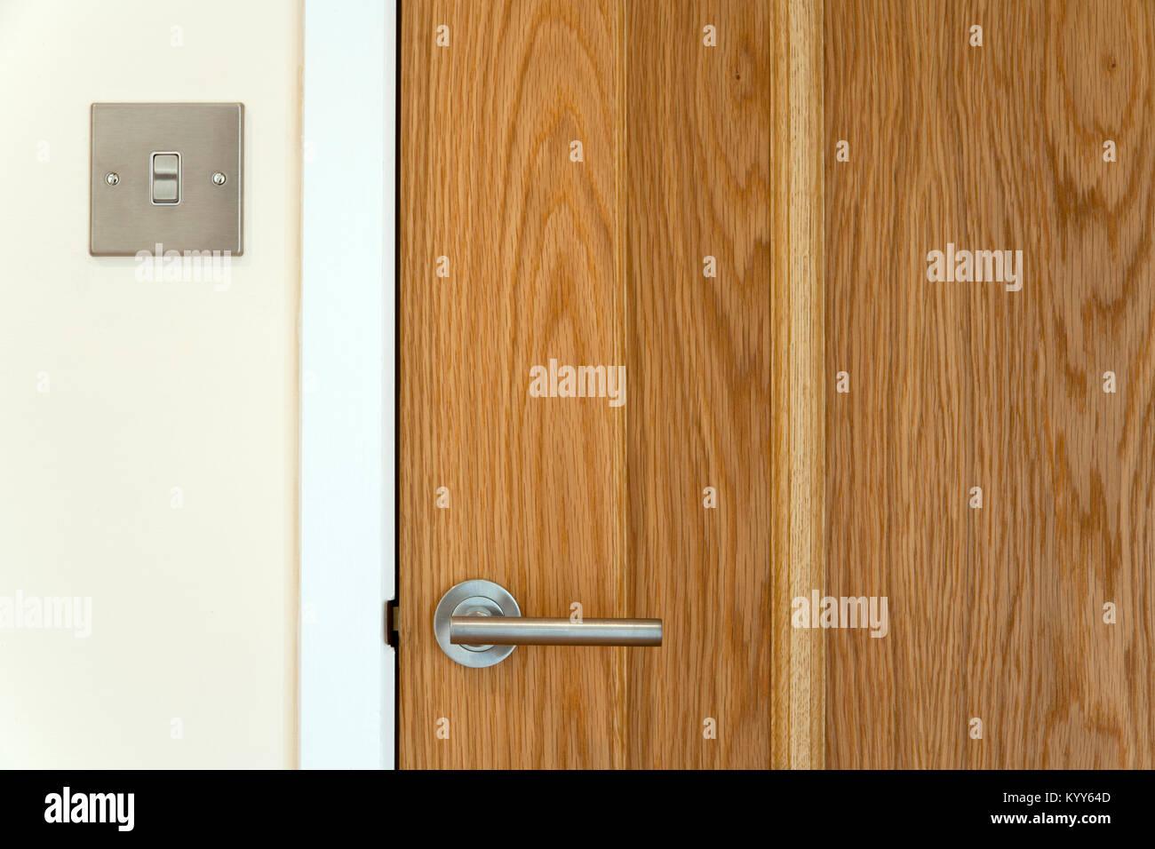 Contemporary Door Handle On A Closed Solid Wood Interior Door Stock