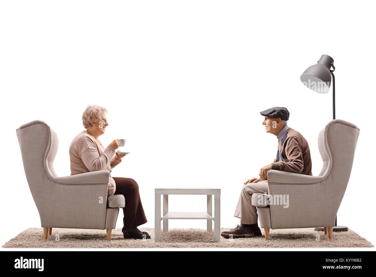 Elderly Woman With A Cup And An Elderly Man Sitting In Armchairs And