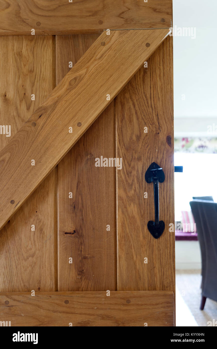 An Open Solid Wood Door With A Glimpse Of Dining Room Beyond