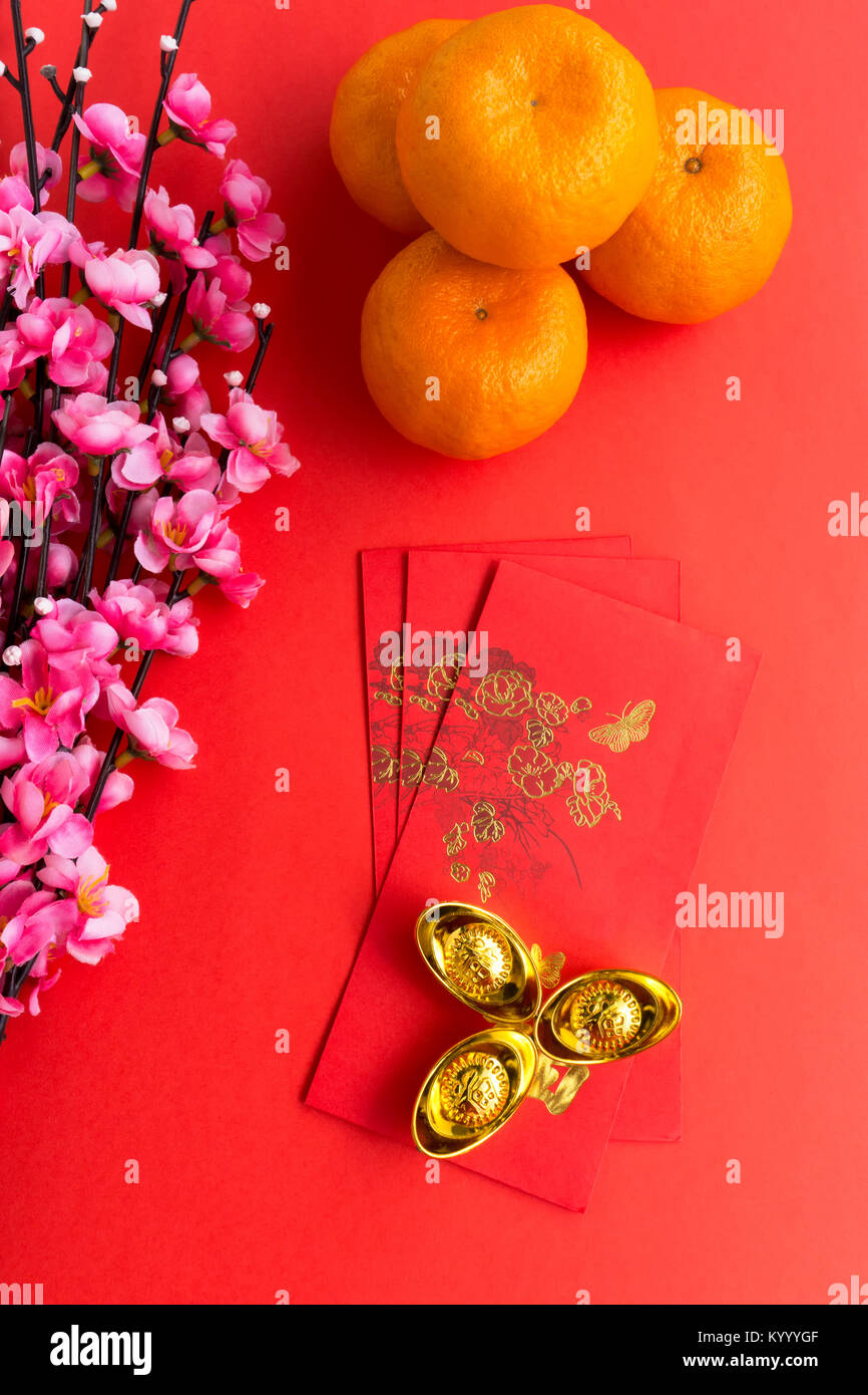 chinese new year background concept chinese new year background ornaments mandarin orange red envelopes plum flowers and gold ingots with chinese