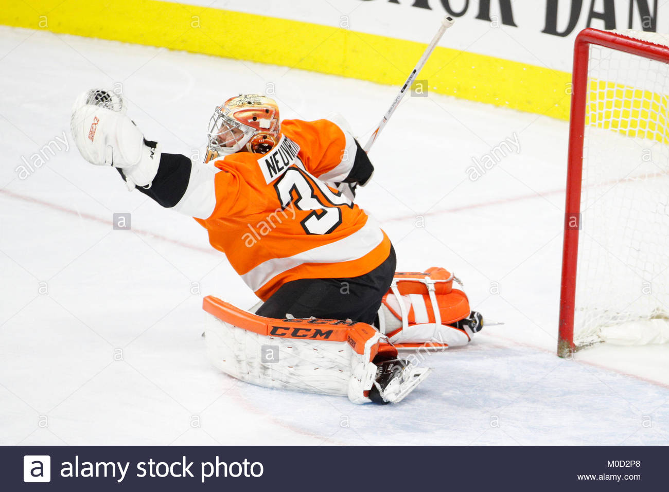 january 20 2018 philadelphia flyers goalie michal neuvirth 30 reaches out to catch the puck during the nhl game between the new jersey devils and