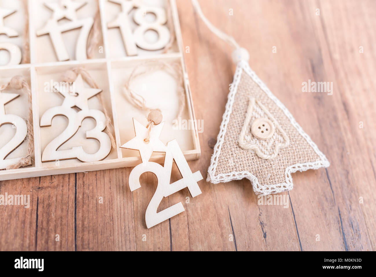 24 days till christmas vintage style wood calendar with festive tree on wooden backgroundchristmas eve time concept - How Much Time Till Christmas