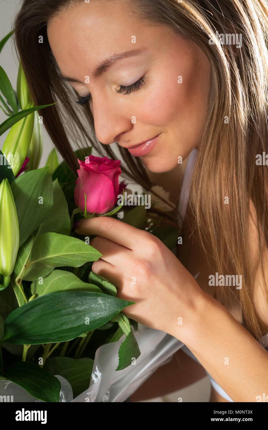 Beautiful woman with flowers stock photo 172583598 alamy beautiful woman with flowers izmirmasajfo