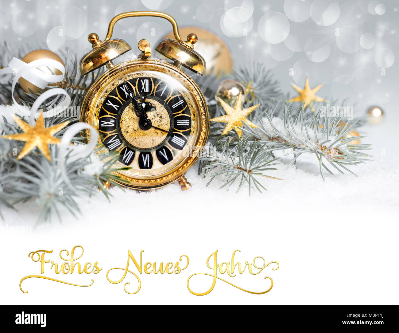 Alarm clock and decorations on snow. New Year greeting card, caption ...