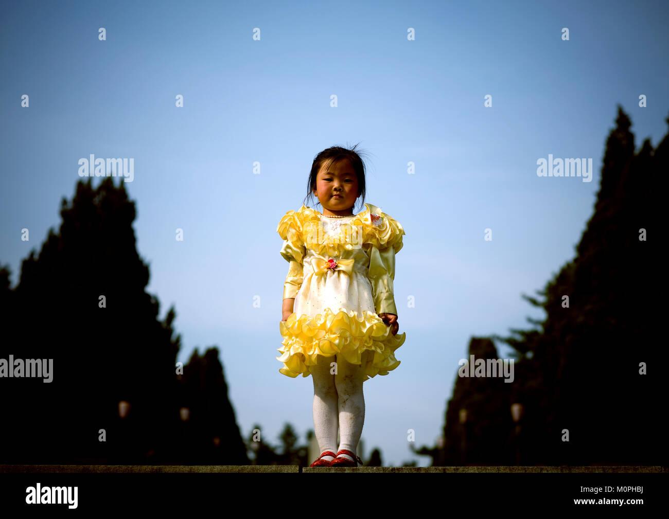 north korean girl wearing her sunday dress, pyongan province stock