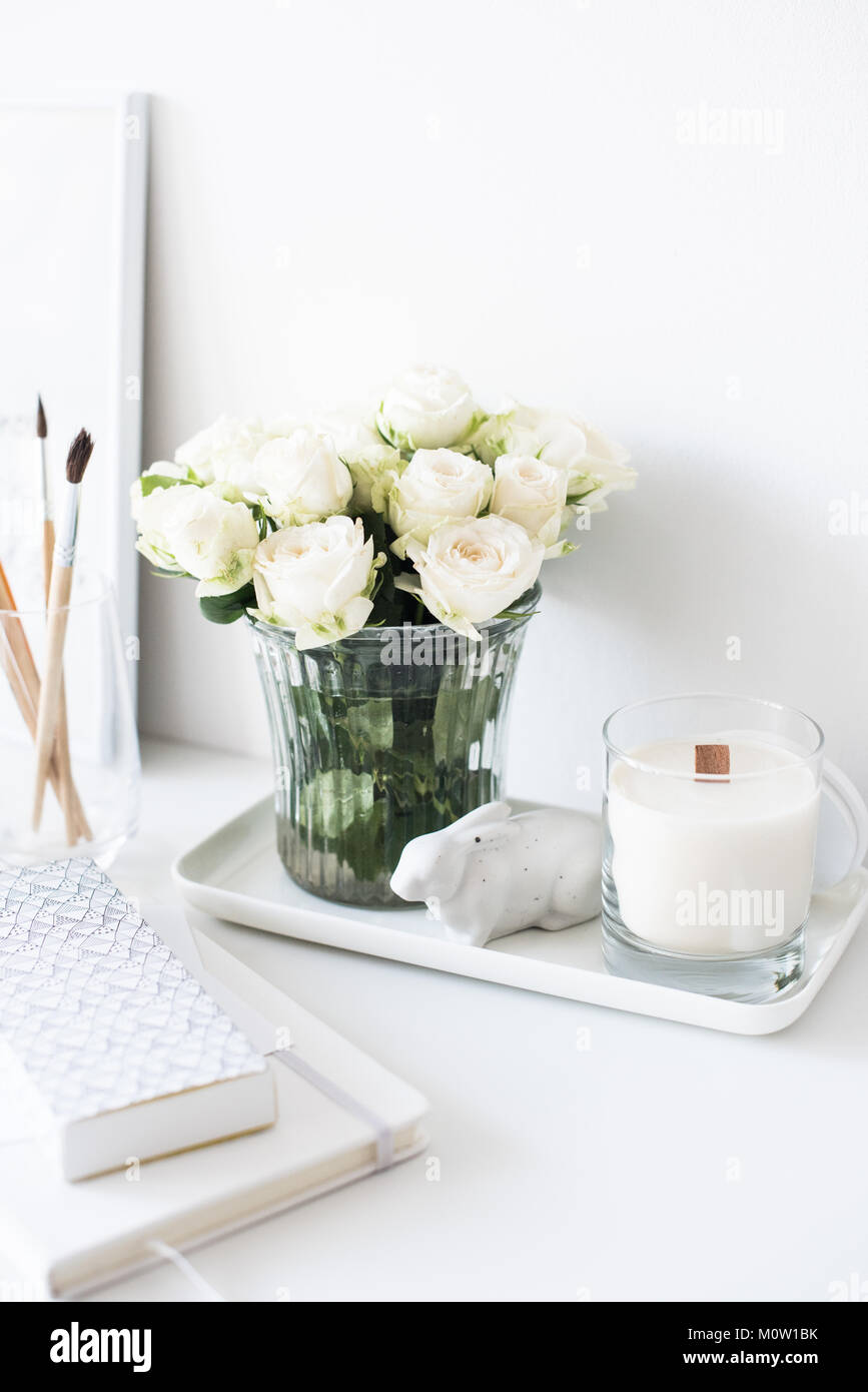 White Interior Decor With New Hand Made Candle And Bouquet Of Fresh Roses, Luxury  Home Decorations In Daylight Closeup