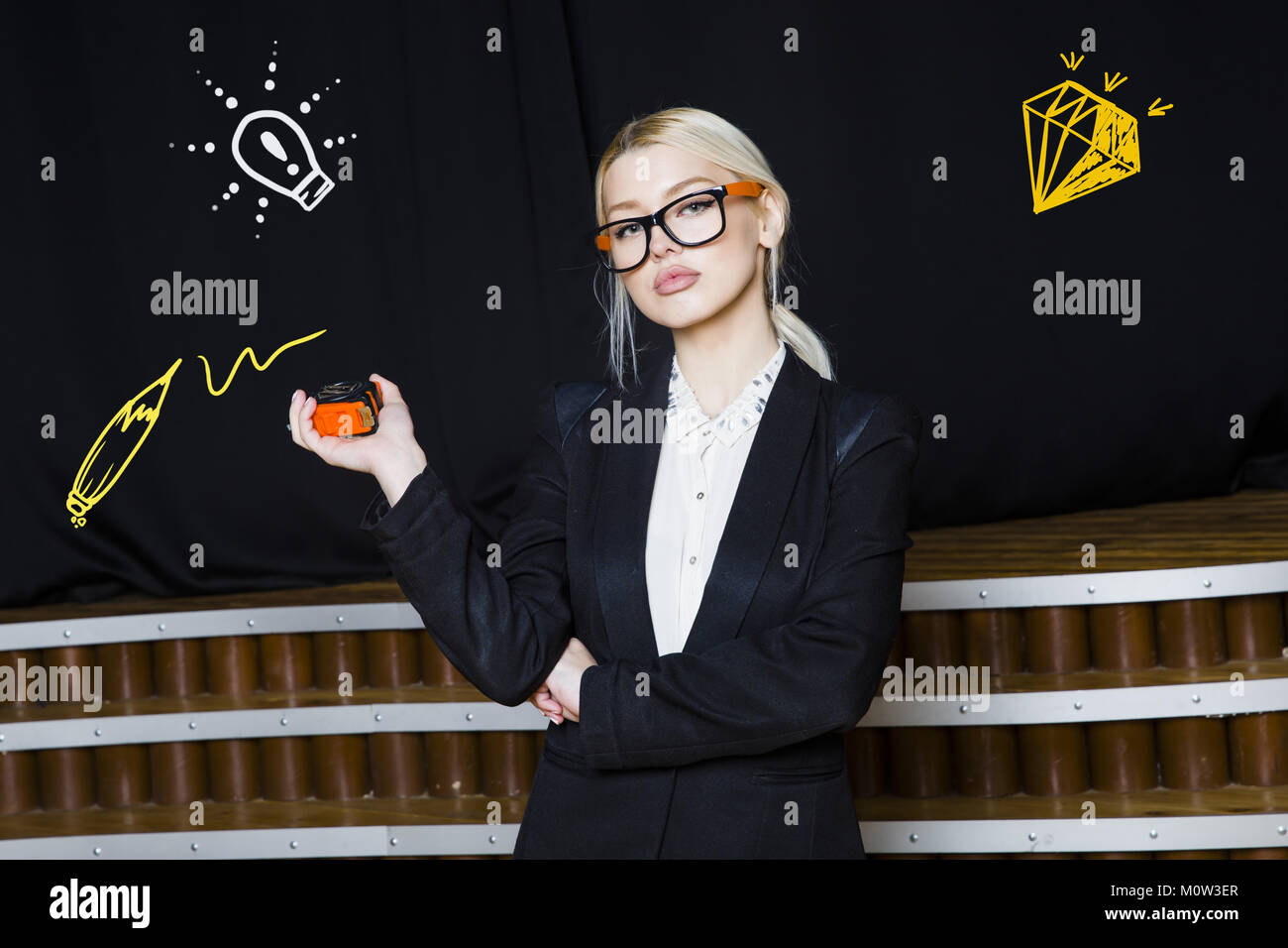 Beauty Blonde Businesswoman With Designer Or Architect Staff Is Standing  Against Concrete Wall With Startup Sketch On It