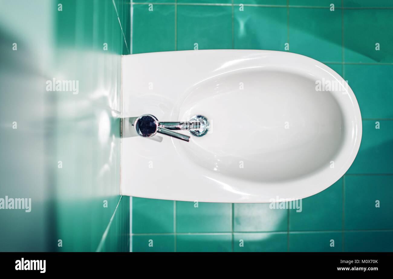 Modern Bidet Fixture Between Emerald Bathroom Tiles Stock Photo ...