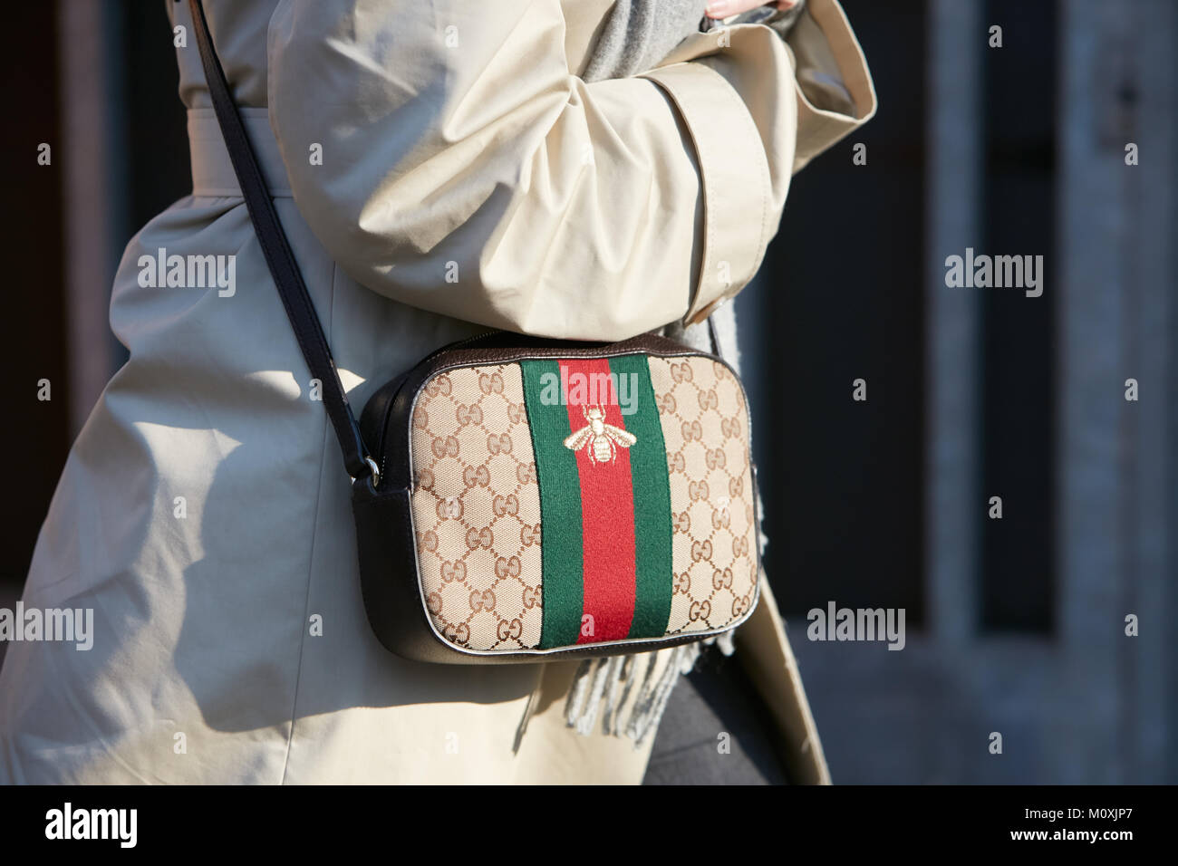 d6620d83b1e MILAN - JANUARY 13  Woman with Gucci bag with bee and green and red stripes before  Emporio Armani fashion show, Milan Fashion Week street style on Jan