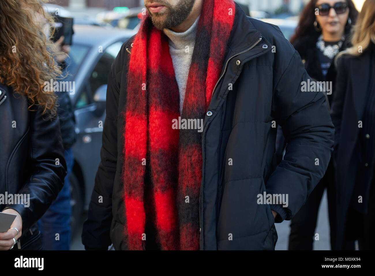 33093f1ebce MILAN - JANUARY 13  Man with red and black scarf before Diesel Black Gold fashion  show, Milan Fashion Week street style on January 13, 2018 in Milan.