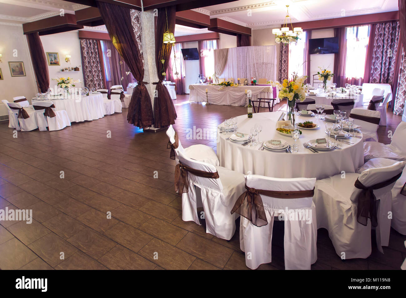 Wedding hall which houses the banquet tables on tables laid out