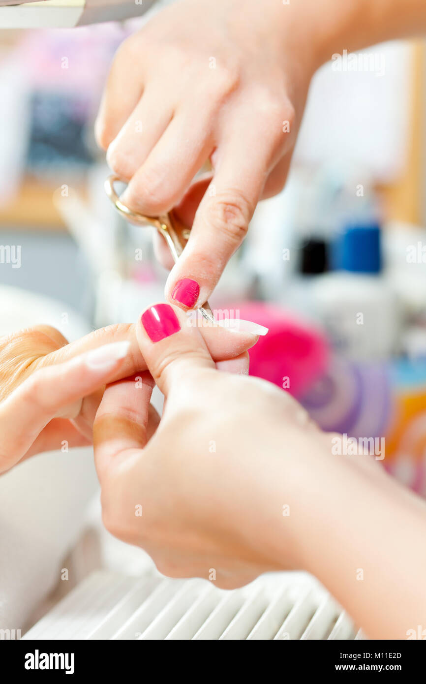 Nail treatment in beauty salon Stock Photo, Royalty Free Image ...