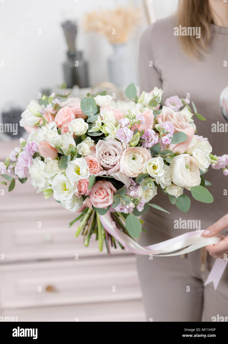Beautiful luxury bouquet of mixed flowers in woman hand the work of beautiful luxury bouquet of mixed flowers in woman hand the work of the florist at a flower shop cute lovely girl izmirmasajfo Choice Image