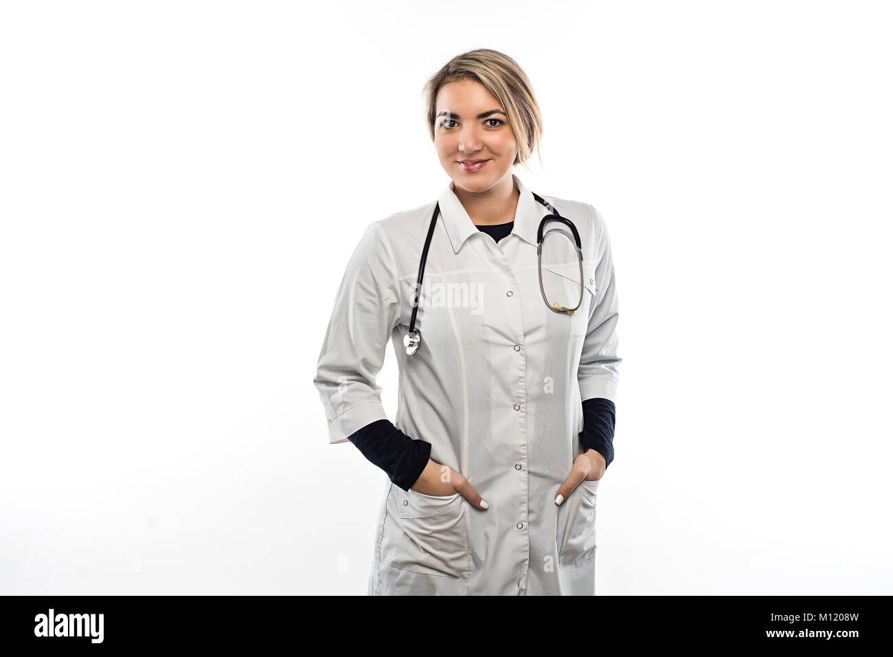 A female doctor in a gown and with stethoscope hanging on her neck ...
