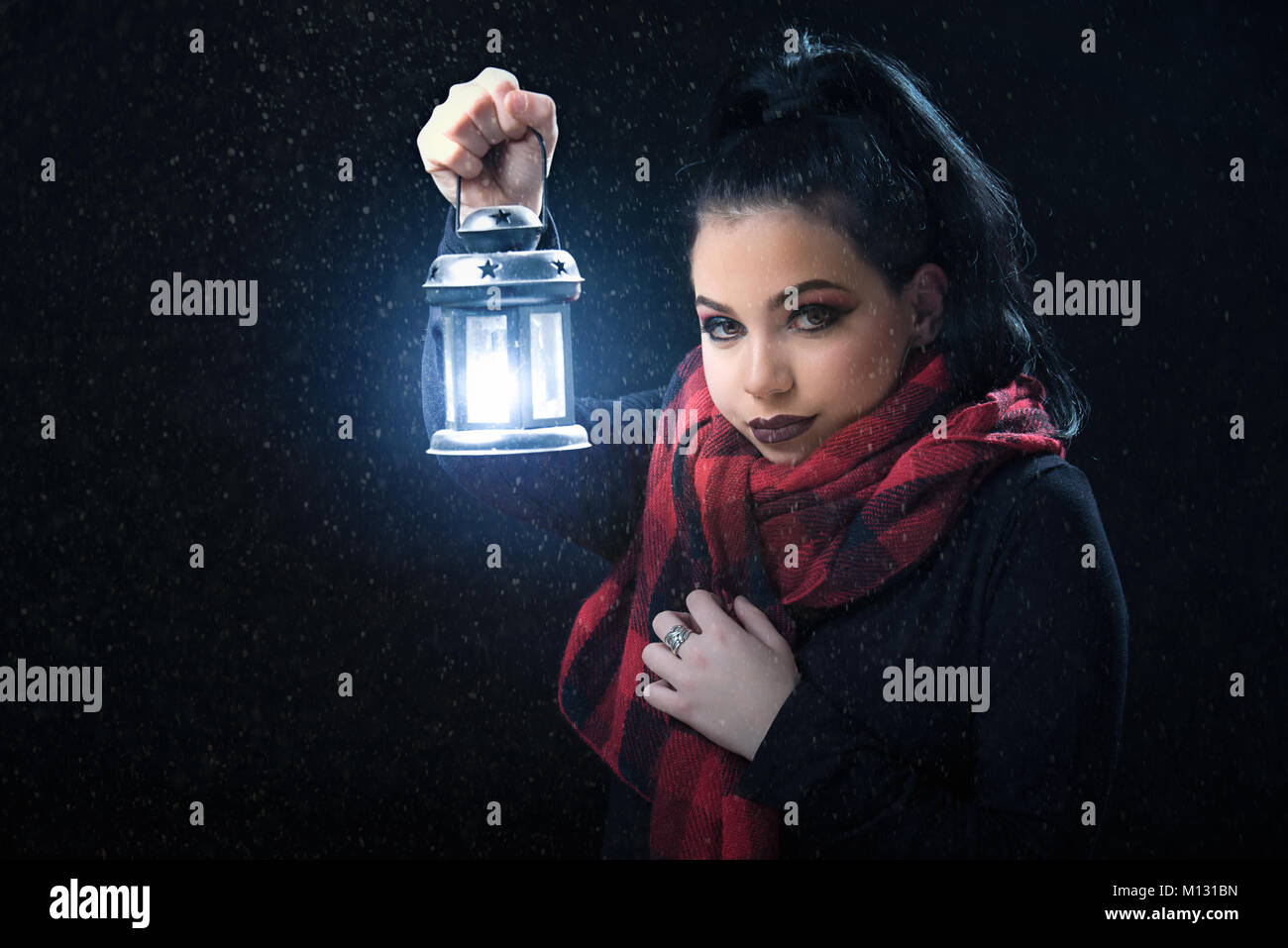 Girl holding the lamp while snowing Stock Photo, Royalty Free Image ... for Girl Holding Lamp  186ref